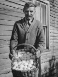 Man Holding Basket Full of Eggs