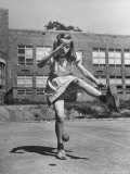 Girl Playing Stickball