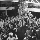 People Reaching For the Balloons at the Palm Beach Party