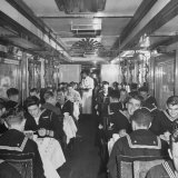 GI Personnel and Their Wives Eating in Dining Car While Civilians Will Have to Wait Until Later