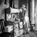 Woman Cooking on Old Fashioned Stove