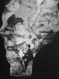 Man Looking at Prehistoric Cave Painting