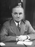 Harry S Truman Sitting at Desk