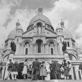 American Travelers Pausing on the Steps of the Sacre Coeur Church to View It's Beauty