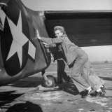 Female Marines Pushing the Tail of a Plane to Turn It Around During Flight Training For WWII