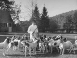 Man Standing with Group of Hounds at Rolling Rock Fox Hunt