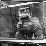 Sculptor W G Lowry Sandblasting Glass Into a Sculpture
