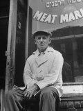 Butcher Taking a Break  Sitting in Front of Meat Market