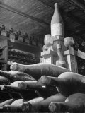 Dust Covered Wine and Brandy Bottles Lying on Racks in a Wine Cellar