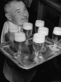 Glasses of Beer Being Served Onboard Oceanliner