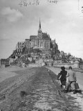 Couple Walking on Causeway Toward Mont Saint Michel