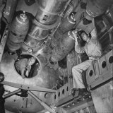 Ordnance Man Inserting Fuse Into 500 Lb Demolition Bomb in Bomb Bay of B-29