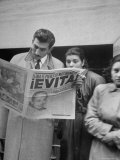 Couple Reading Newspaper Account of the Death of Evita Peron at 33 from Cancer