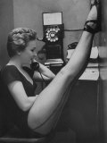 Dancer Mary Ellen Terry Talking with Her Legs Up in Telephone Booth Papier Photo par Gordon Parks