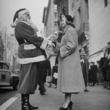 Secretary Eileen Godsil Talking with a Department Store Santa Claus on 5th Avenue