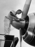 Eastern Airline Employees Working on the Maintaining an Aircraft's Engine