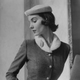 Model Wearing Tweed Suit and White Plush Hat