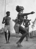 Australian Aborigines Dancing with a Child Watching in the Background