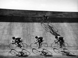 Bicycles Forming Distorted Designs on Track as Peddlers Grind Away in the 4 000 Meter Team Pursuit