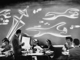 Dimly Lit Wall of the Sea Restaurant  with Customers Reading Their Menus with Flashlights