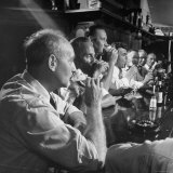 Men Gathered Around For Their Weekly Meeting Indulging in Glasses of Beer