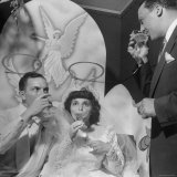 Bride and Groom  Mr and Mrs Salvatore Cannella  Sitting under Silvered Halos  Sipping Champagne