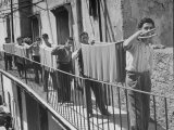 Boys Working in Pasta Factory Carry Rods of Pasta to Drying Rooms