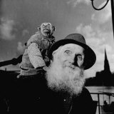 Old German Circus Artist Nikolaus Munz with His Pet Monkey  Waiting to Board a Small Ferry