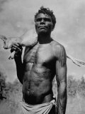 Australian Aborigine Holding a Freshly Killed Animal Used as a Food Source