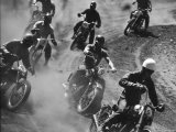 Amateur Motorcycle Racers Kicking Up Clouds of Dust During Race