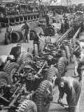 French Army Mechanics Busy Assembling Tires on the Chassis of 3/4 Ton American Made Army Trucks