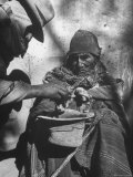 Beggar Being Given Coca Leaves