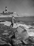 Man Fishing Off Montauk Point Montauk Lighthouse Visible in Background