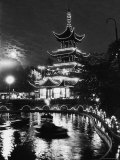 Chinese Styled Tower Viewed from Across an Ornamental Lake at Night in the Tivoli Amusement Park