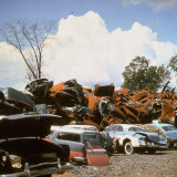 Pile of Rusting Cars in Automobile Junkyard