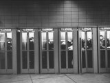 Busy Telephone Booths During an Airline Strike