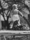 Baby Jumping on a Trampoline