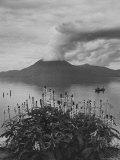 Panorama of Lake Atitlan with Volcano Smoking in Background