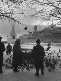 Attendant Feeding Pigeons in Red Square