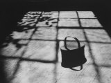 Handmade Covered Basket Sitting on Floor in a Sunlight Grid of Shadows at Shakertown Museum
