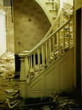 Elegant Curving Stairway Amid Rubble in Building under Demolition  in New York City