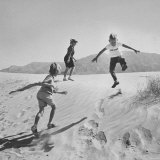 Children Playing in the Desert Sand