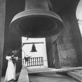 Monk Ringing Bell in Plaza de Armas