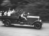 Kids Riding on Back of Old Fire Engine