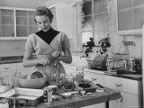 Attractive Housewife in Modern Kitchen  Preparing Food