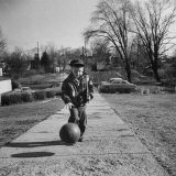Six Years Old Teddy Cox Practicing His Basketball Dribbling During His Travel to School