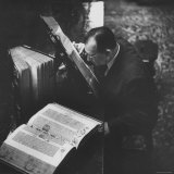 Reverend Don Cleveland Norman Examining Ancient Bibles