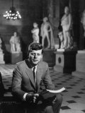 Senator John F Kennedy Seated in Museum with Statues
