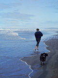 Presidential Candidate Bobby Kennedy and His Dog  Freckles  Running on an Oregon Beach