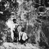 Albert Thornton's Grandson's Fishing Papier Photo par Gordon Parks